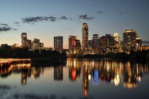 the Austin skyline at twilight, with ladybird lake