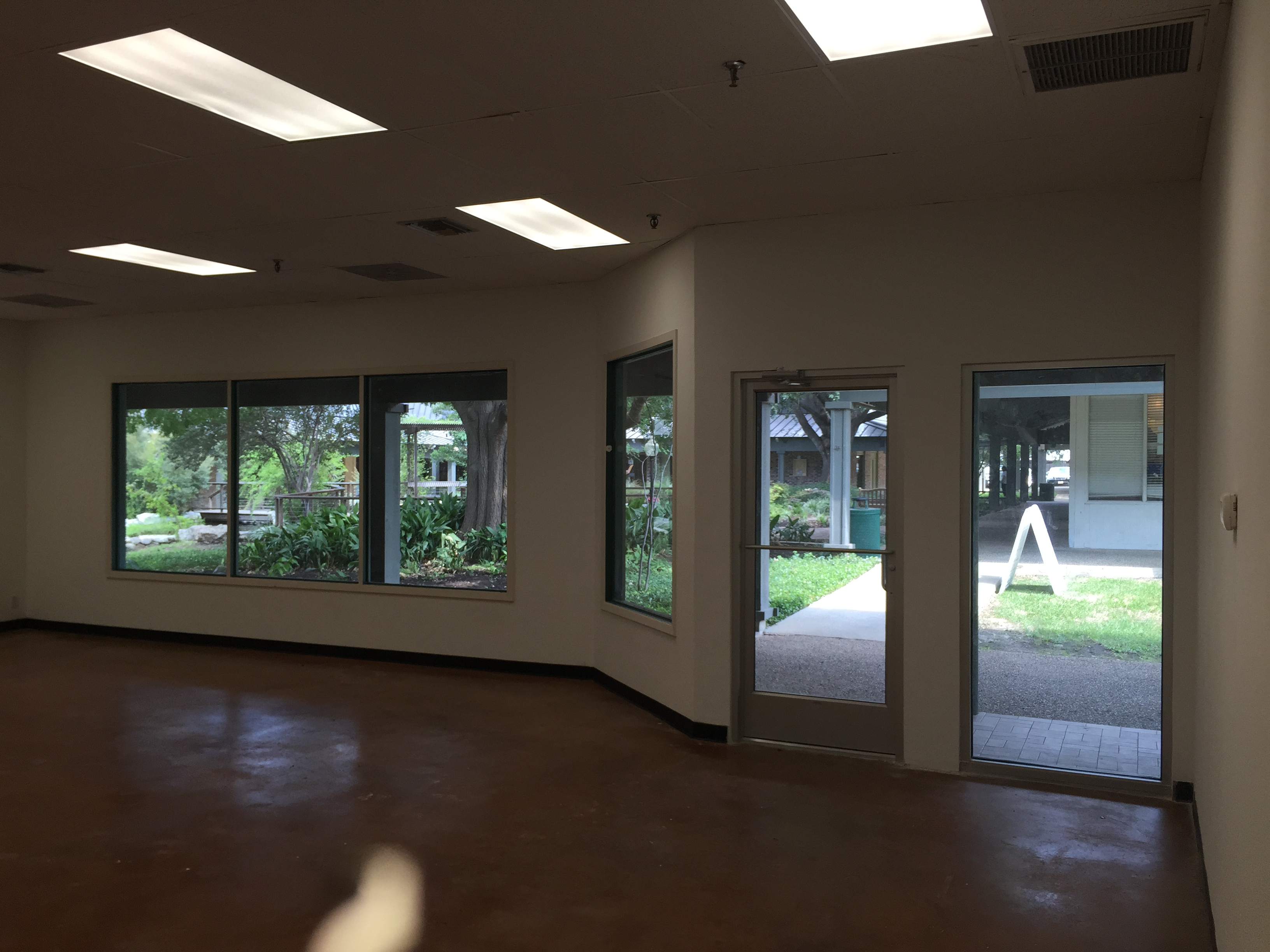an image of a vacant storefront taken with an iPhone