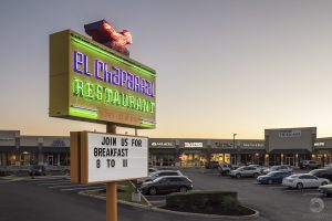 an elevated image of El Chapparal restaraunt's sign in San Antonio at twilightt