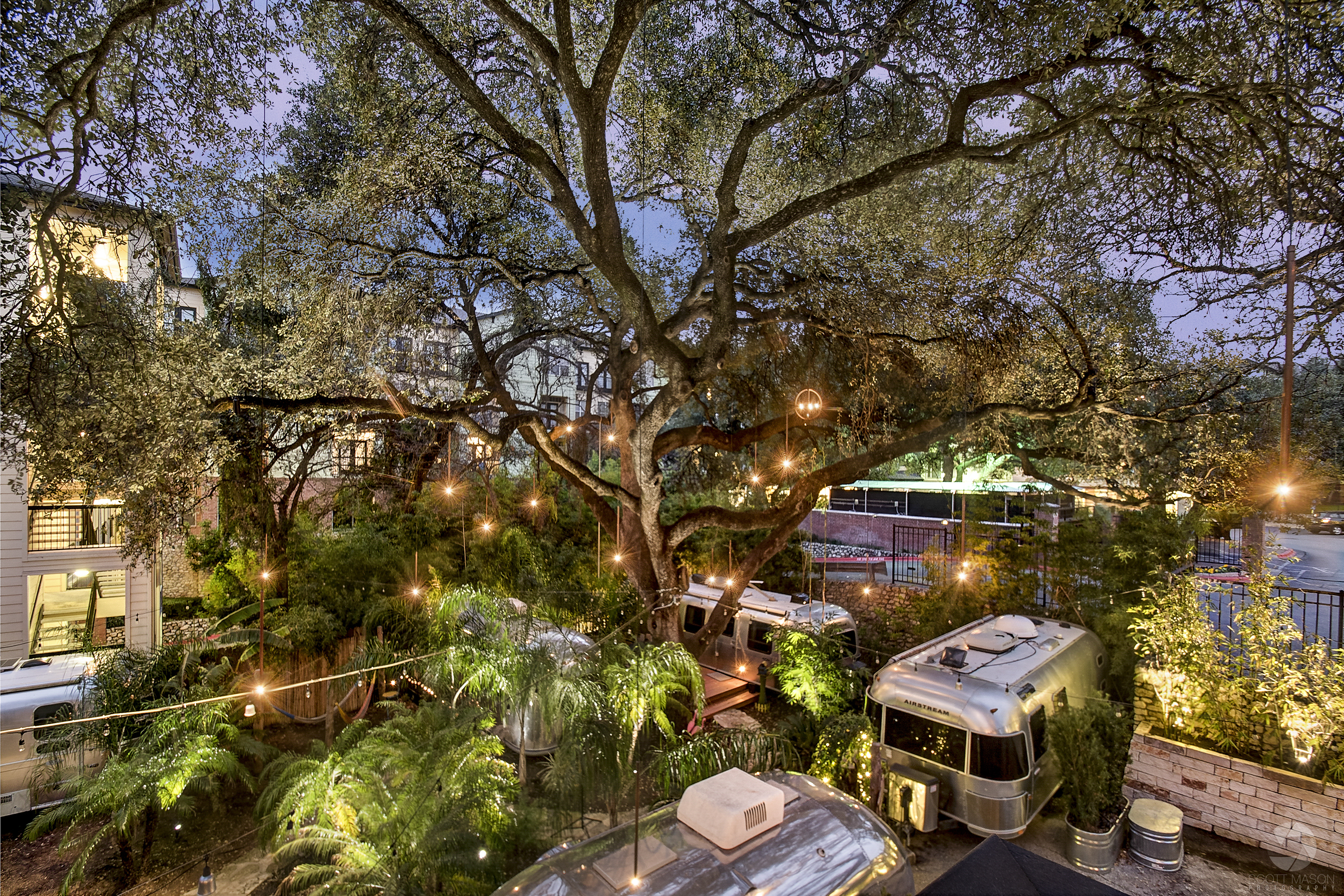 a twilight photo of an outdoor lighting setup in White Hat Airstream Park in Austin, TX