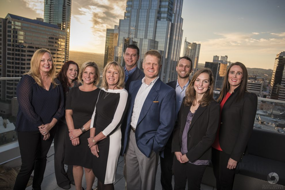 a group business portrait of a company on the roof of the Westin in Austin tx at sunset
