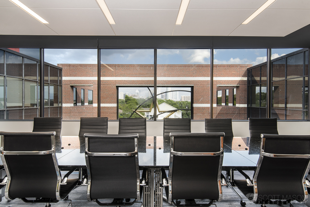 a photo of Aquila Commercia's conference room, looking from behind chairs out the window
