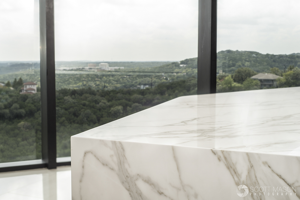 a close-up photo of the corner of a Neolith kitchen island