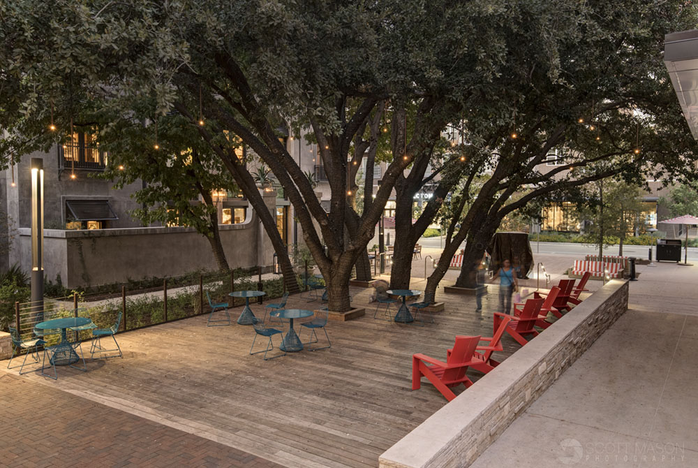 a photo of a commons area at the Domain Austin with people walking through it