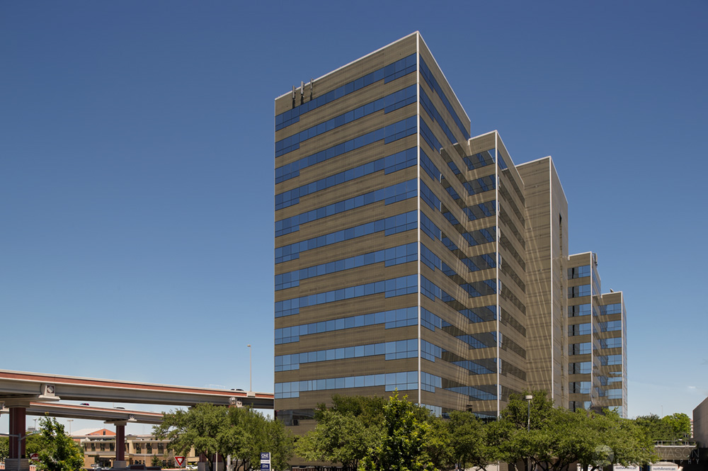 a daytime architectural photo of the exterior of One International Center building in San Antonio
