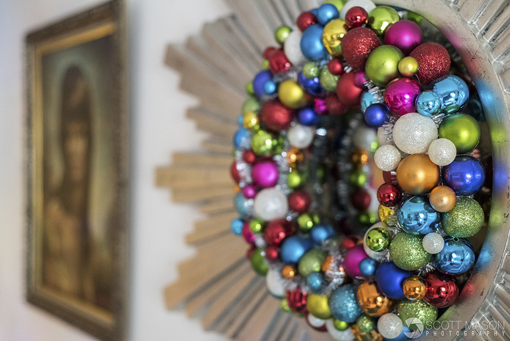 a close-up of a mirror decorated with a christmas ornaments wreath