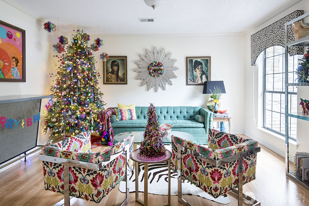 a room with vintage furniture and christmas decor
