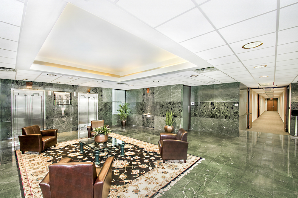 An interior of an elevator bank/lobby