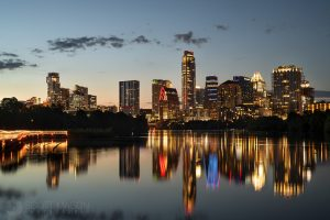 the Austin skyline at twilight, with ladybird lake