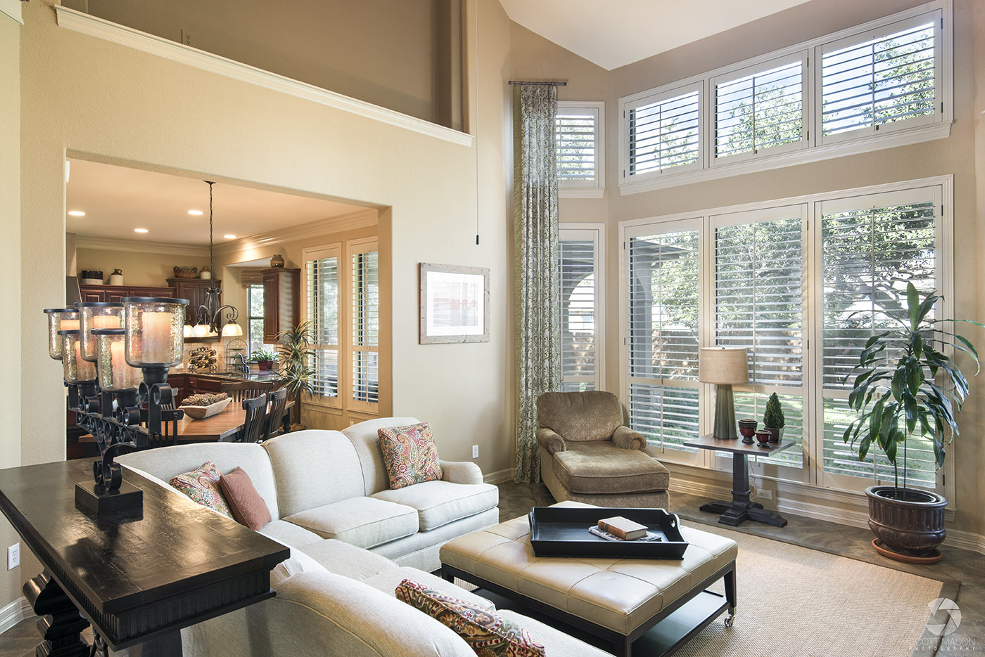 a real estate photo of a living room with large windows