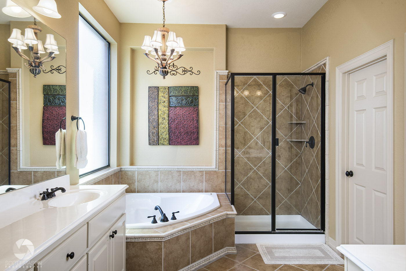 a photo of a nice master bathroom with tub and shower