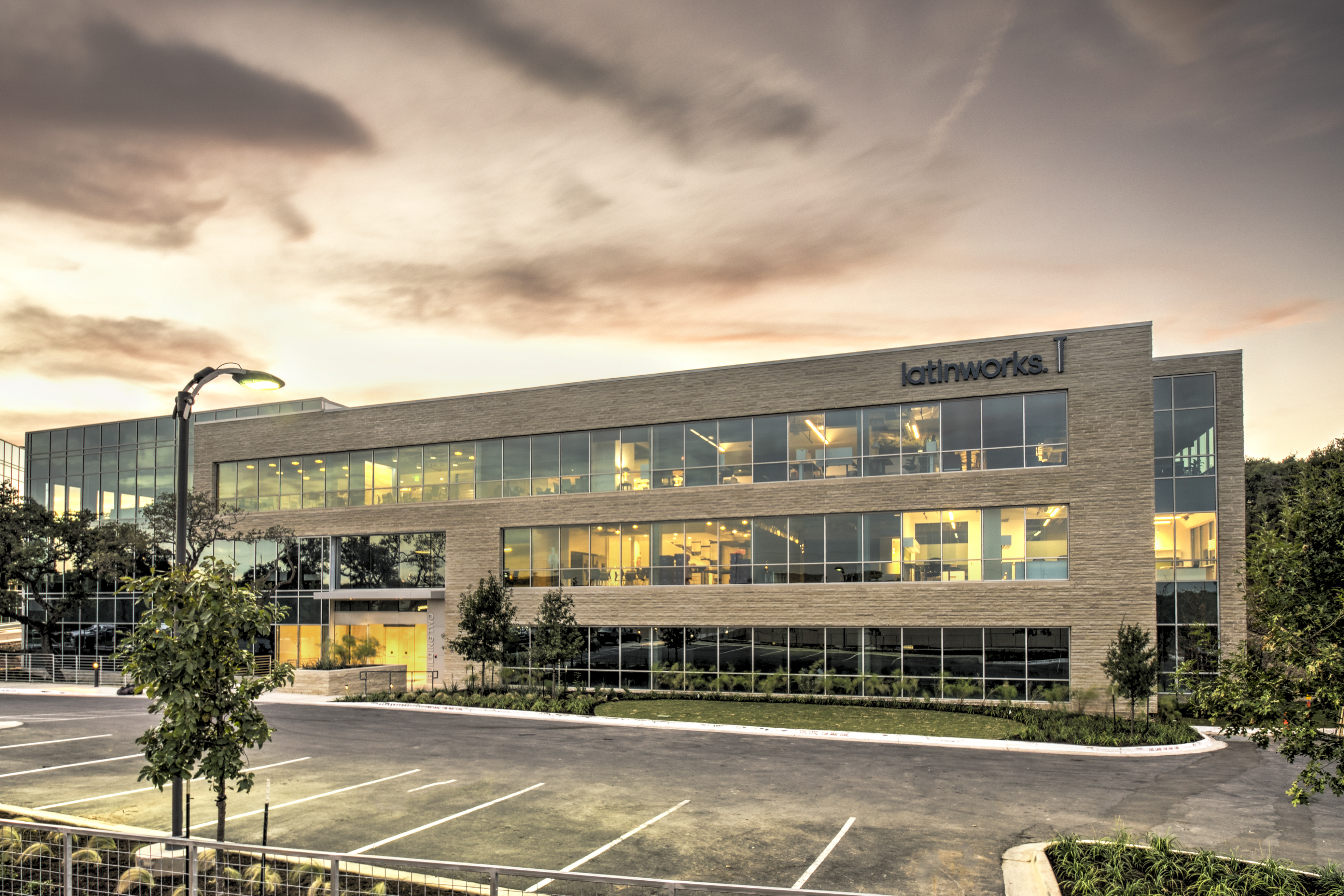A photo of Latinwork's office building exterior at sunset in Austin, TX