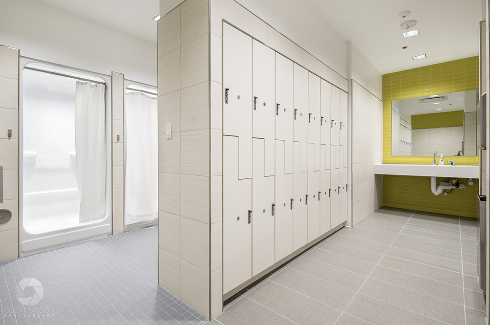 a photo of a locker room with showers