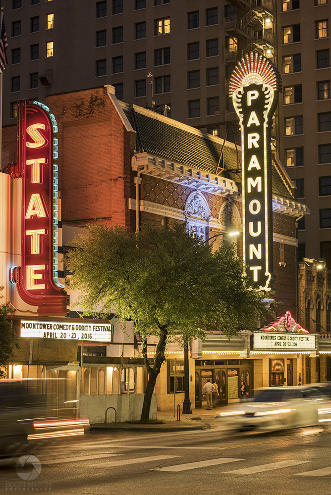 a nighttime photo of the Paramount and State theaters in downtown Austin
