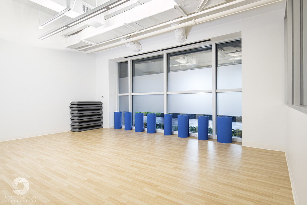 a phot of a yoga room in a fitness center