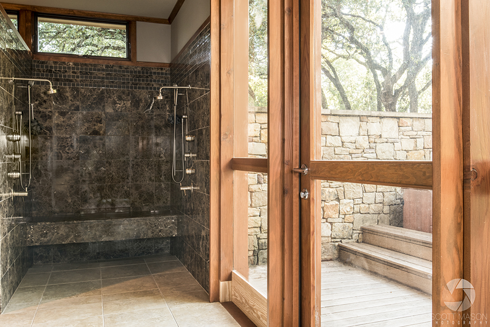 a commercial image of a wood door a builder installed in a house next to a marble shower