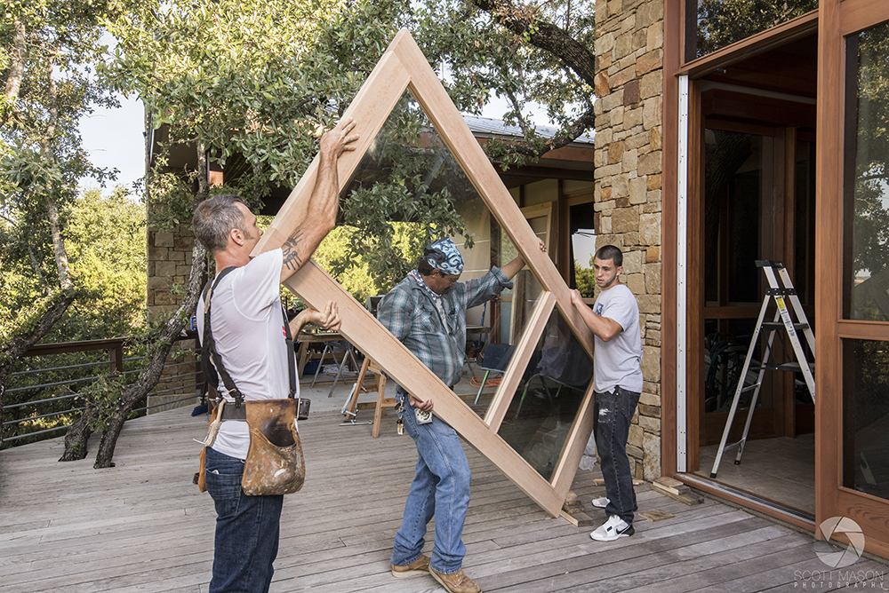 a photo of carpenters installing a door in a home