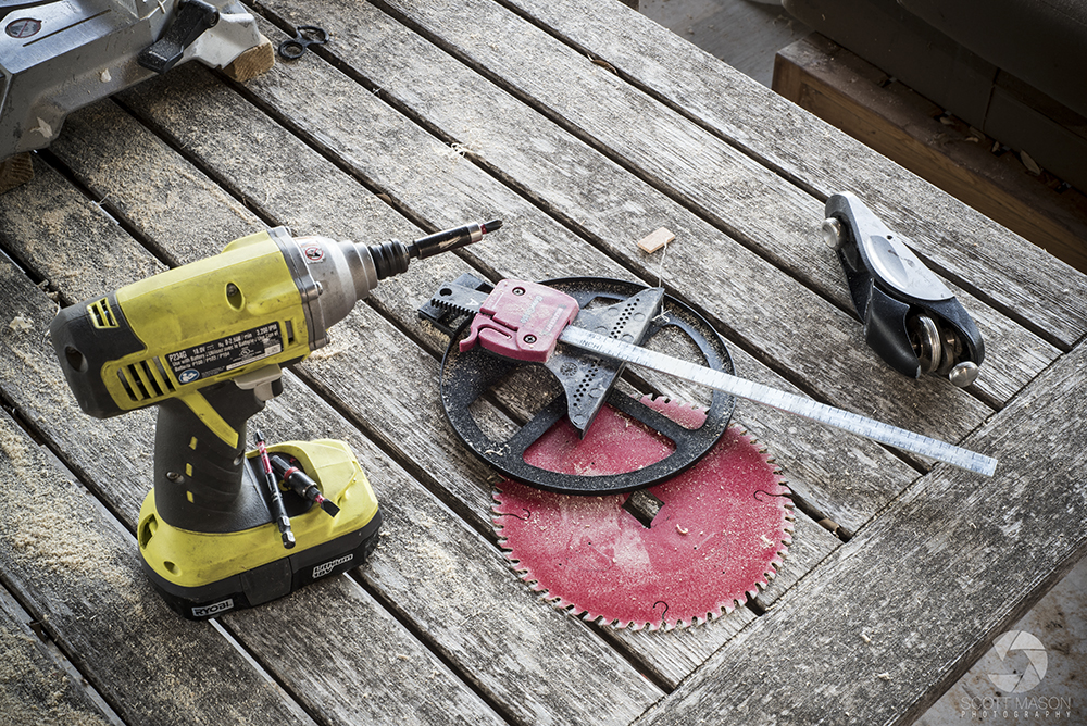 a detail photo of carpentry tools on a wood table