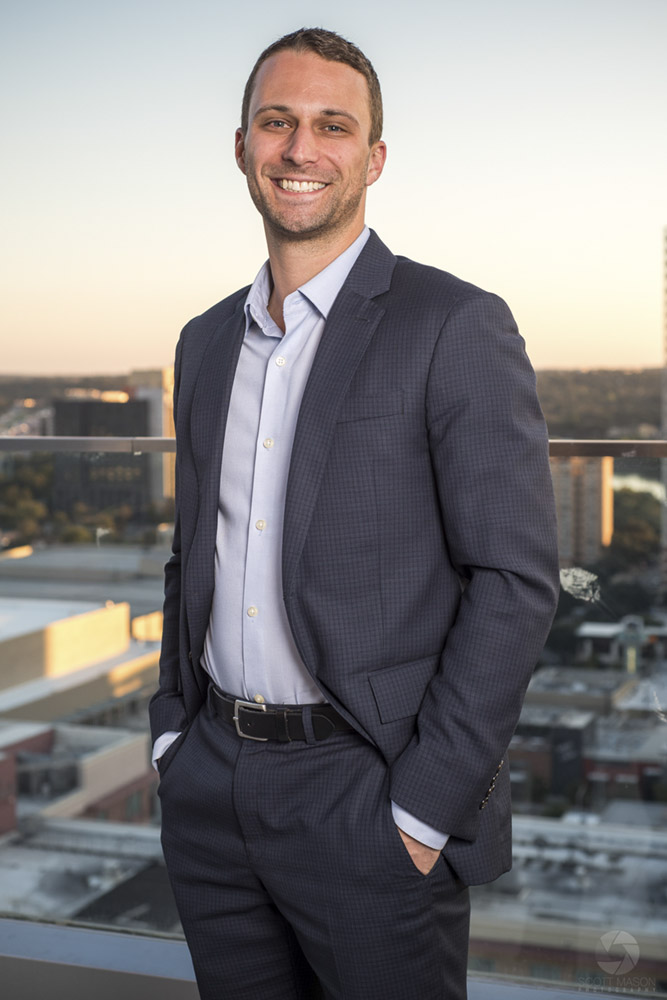 a business portrait of a man on the roof of the Westin hotel in Austin