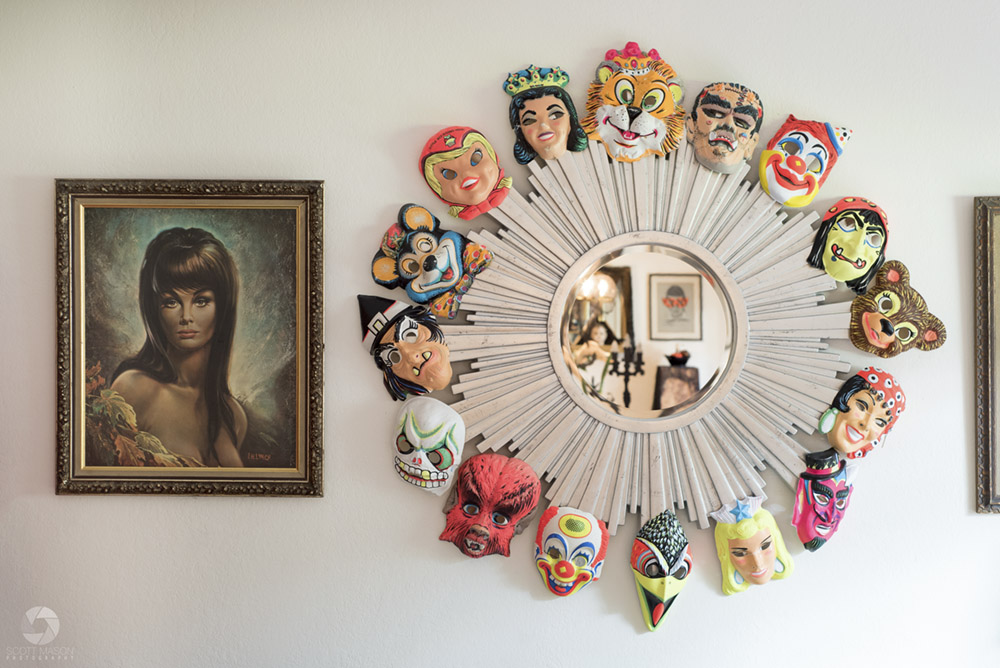 a detail photo of a mirror with vintage masks on it