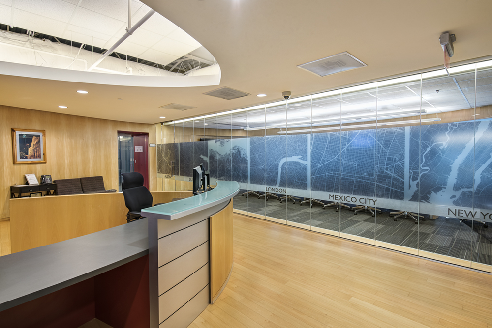 an office lobby with frosted glass window