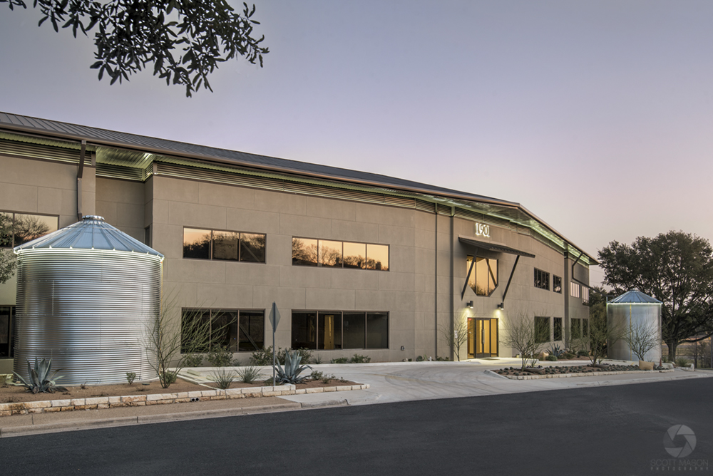 a twilight exterior photo of an office building
