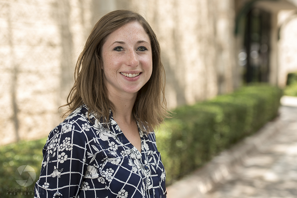 a corporate portrait of a woman smiling outside in front of an office building in Austin