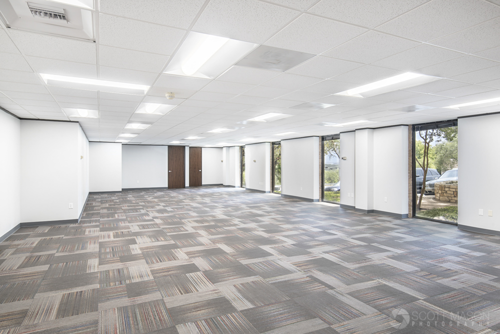 an architectural image of a vacant office suite