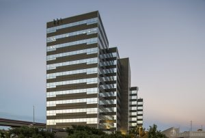 a sunset architectural photo of the exterior of One International Center building in San Antonio