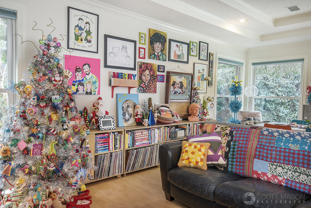 an interior photo of a colorful living room decorated with Christmas items