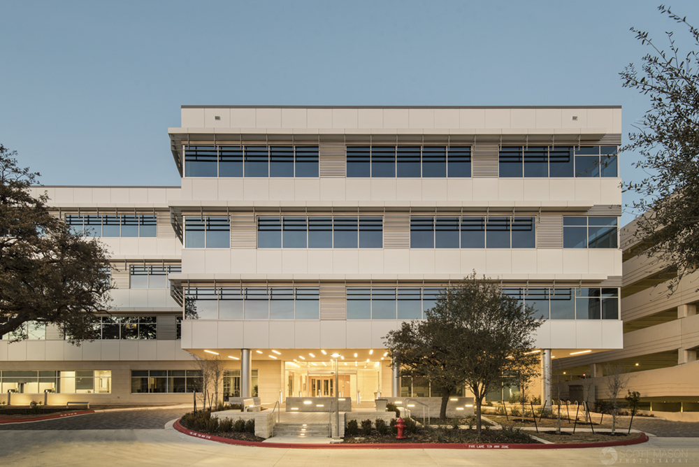 an architectural photo of the exterior of Mopac Centre in Austin at twilight