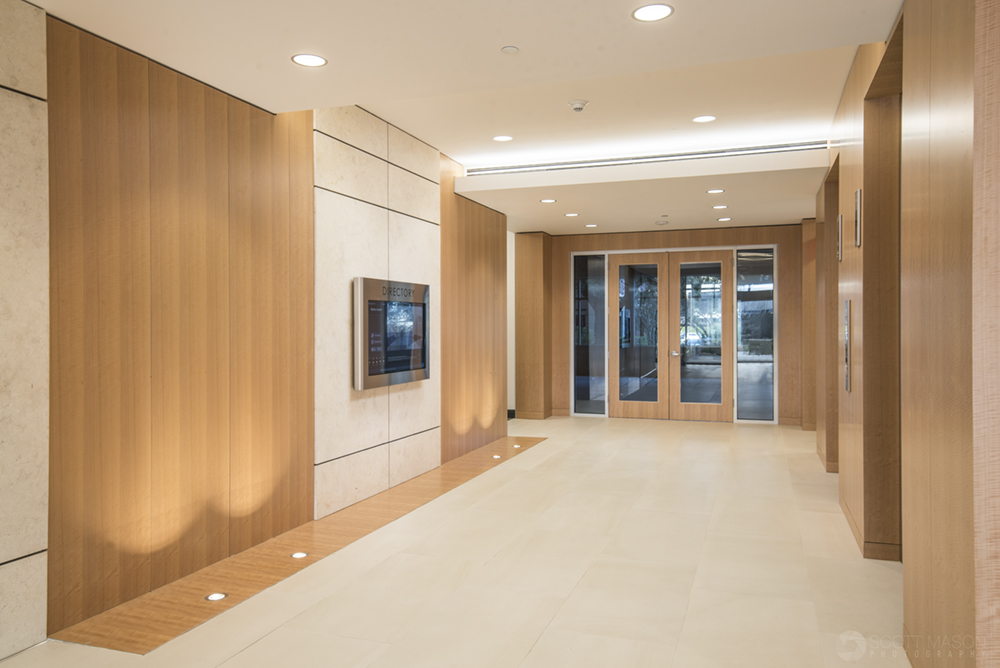 an interior architectural photo of the elevator bank of Mopac Centre in Austin at twilight