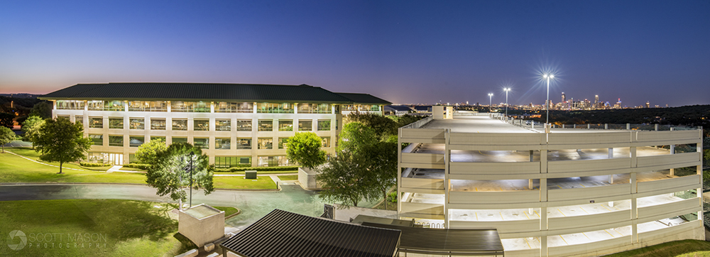 a panorama view of a commercial office building at twilight