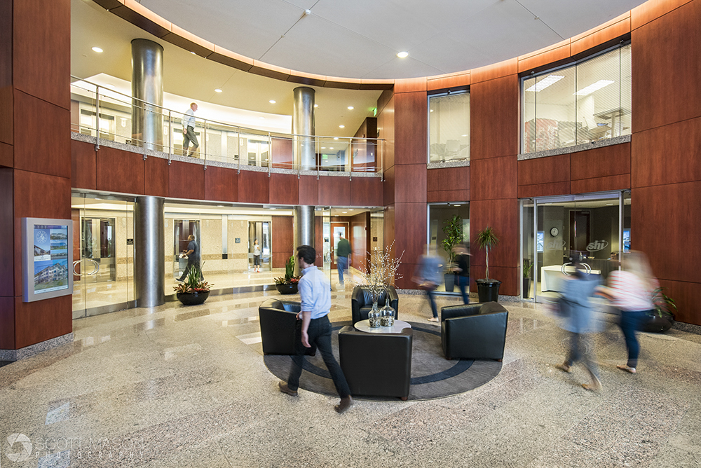 an interior lobby photo with people walking around inside