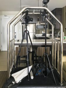 camera gear on a bellman cart in a hotel room