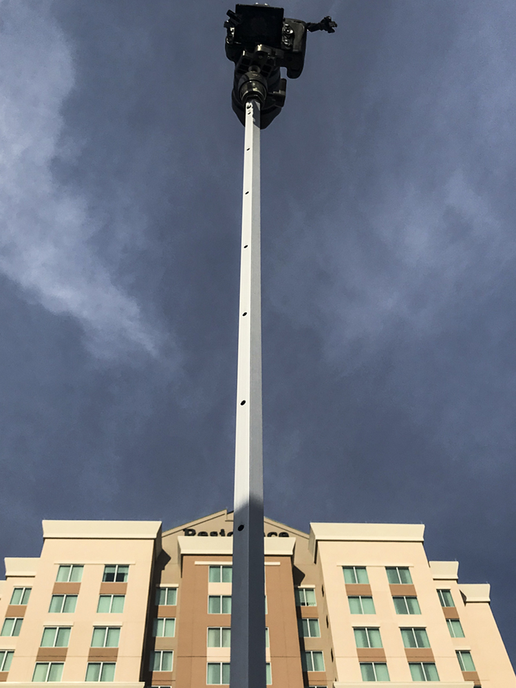 photo of a camera on a pole in front of a hotel