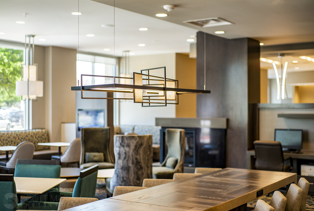 a photo showing a light fixture in the dining area of a hotel