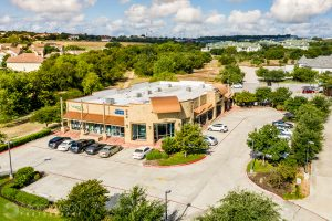 an aerial photograph of an shopping center in Austin