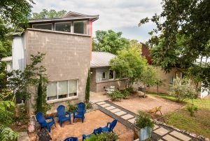 an elevated front exterior photo of a house in east Austin