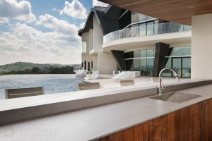 rear exterior photo of a luxury mansion in Austin with a bar and pool