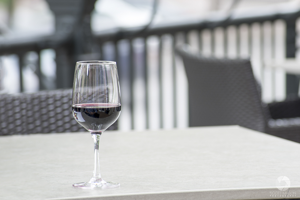 a detail shot of a glass of wine on a table