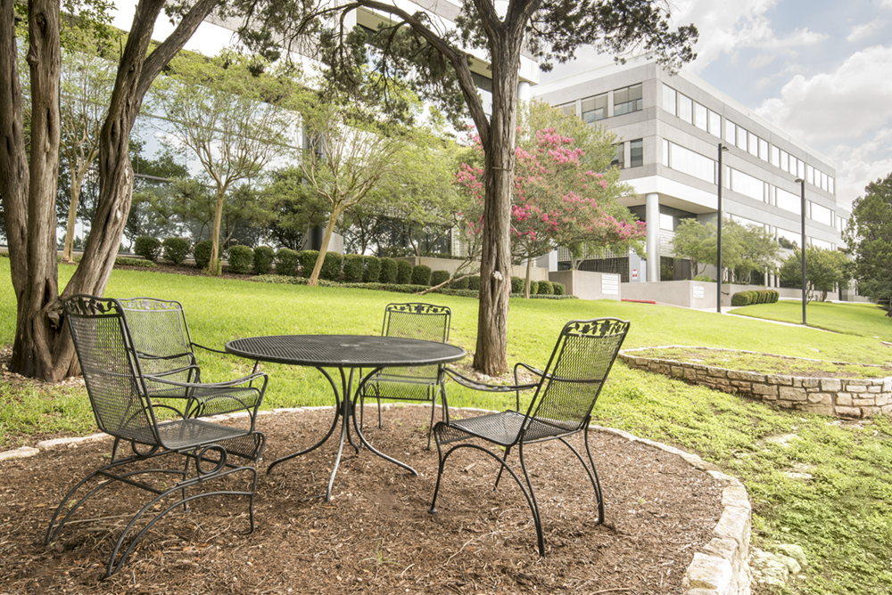 a photo showing a table and chairs in front of the Bridgepoint office building